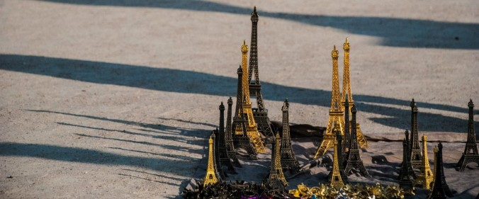 Photo of Eiffel Tower statues. Copyright Edward Borlase